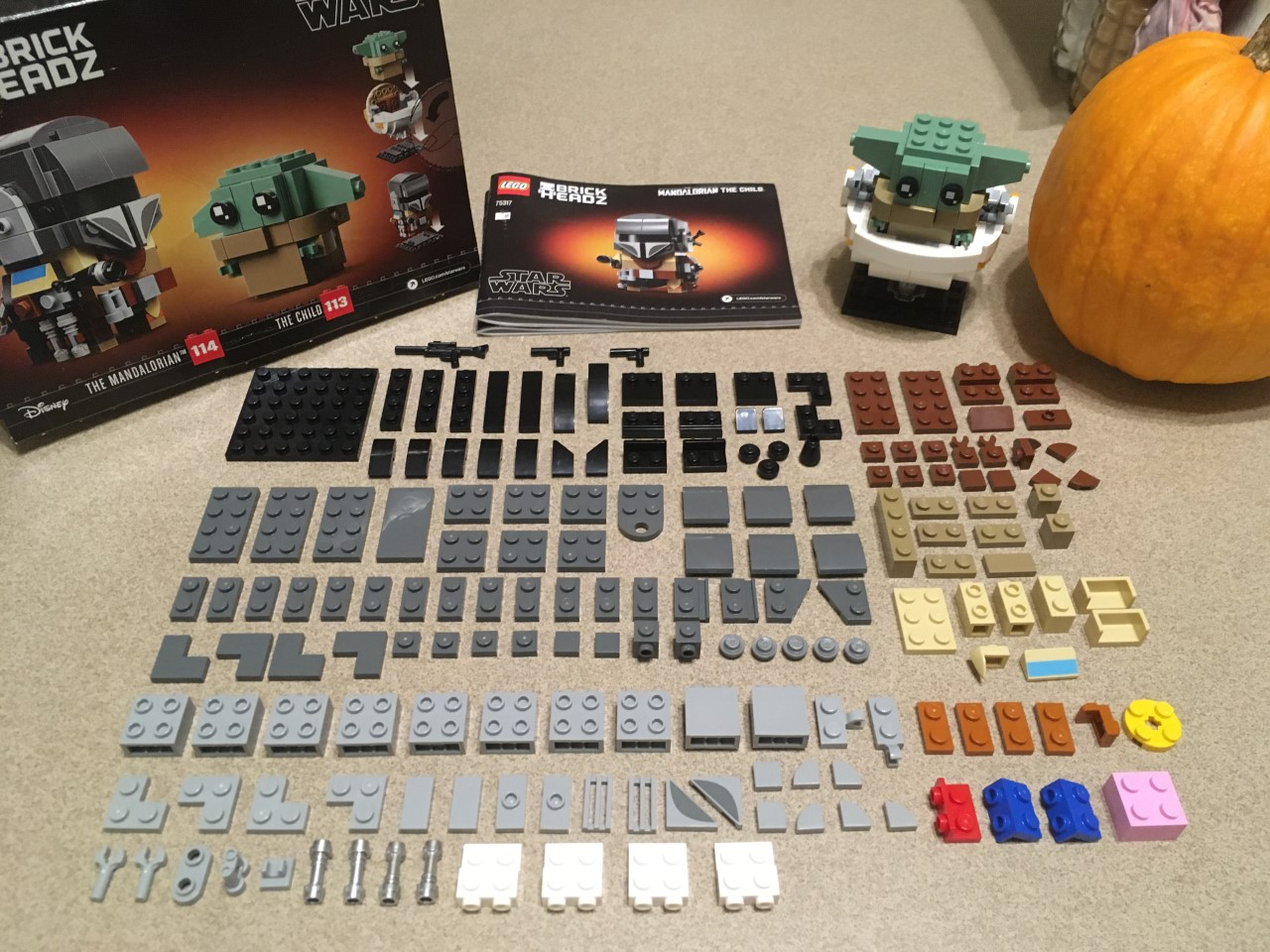 Me knolling Star Wars The Mandalorian LEGO set before building it. Some of you, like me looking at the photo now, will notice the black piece out of place and be annoyed by it.